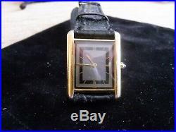 Man's Cartier 18k Tank Watch